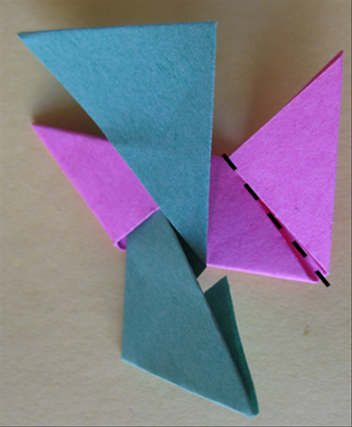 <p> Result Fold the right side down and insert it under the botton flap.</p>