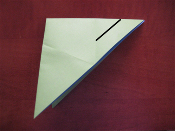 Cut a slit from the top at the right  until the crease.