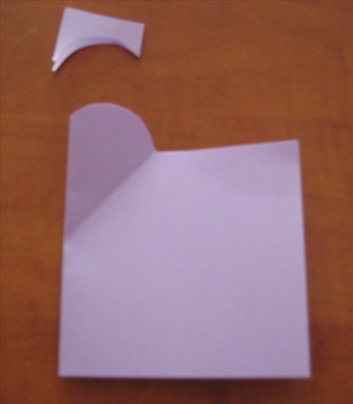 Start at the top of the angle crease point and cut away an arch shape as shown.