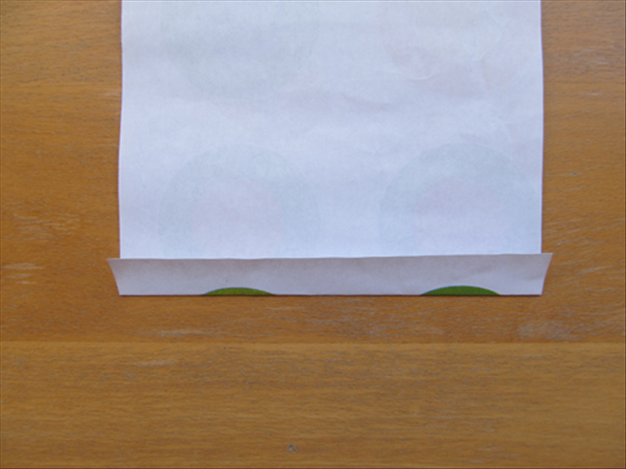 Turn the paper so that the short edges are at the top and bottom. Make a fold about ¾ inch