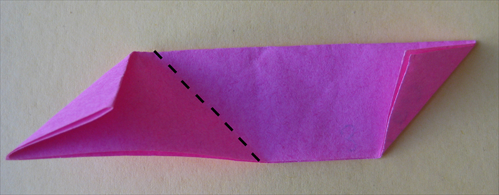 <p> Take the first paper you folded and fold it up from the center crease.</p>