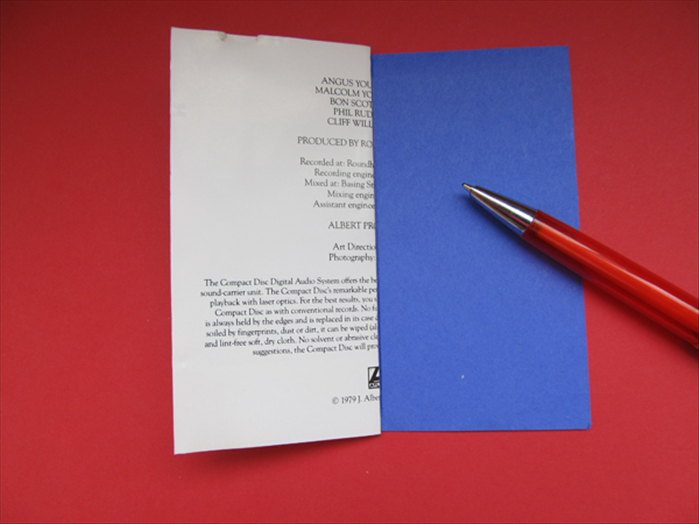 Align the folded paper to your background paper and use the edge to make a straight line.
