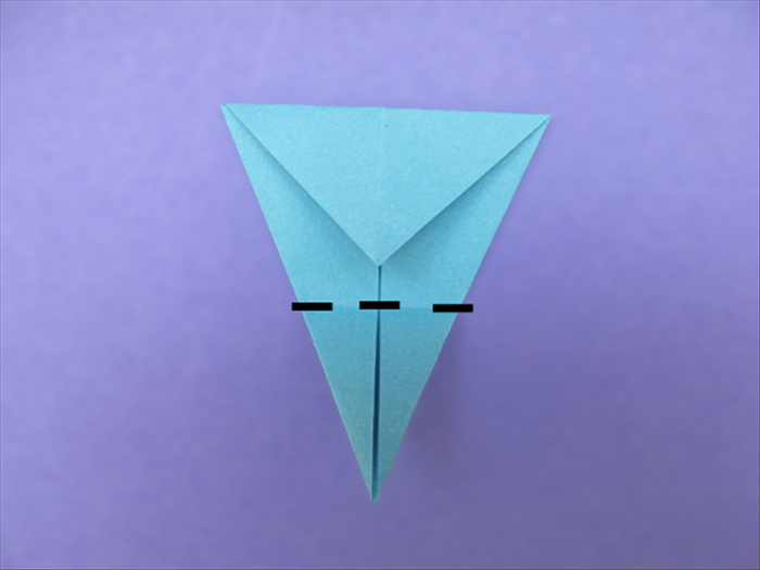<p> Fold the bottom point up to the top.</p>  <p>  </p>