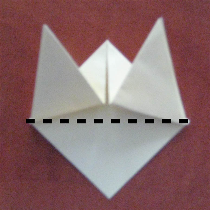 Fold the bottom layer up where it meets the outside edges of the two triangles above it.