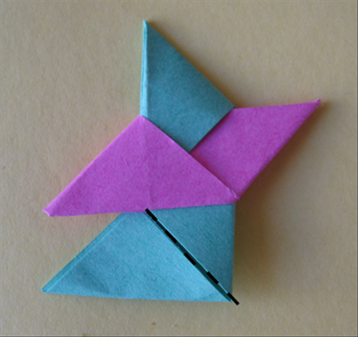 <p> Tuck it all the way. Fold the bottom along the flap</p>