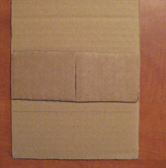 <p> Place the 2 rectangles next to each other with the shorter edged touching to measure and mark the front and back of the box bottom. Use a ruler to draw the shape. Make another for the back piece Cut out the 2 pieces of cardboard.</p>
