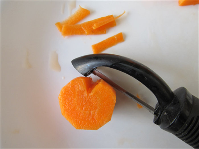 Stroke the vegetable peeler across the top a few times to round it off