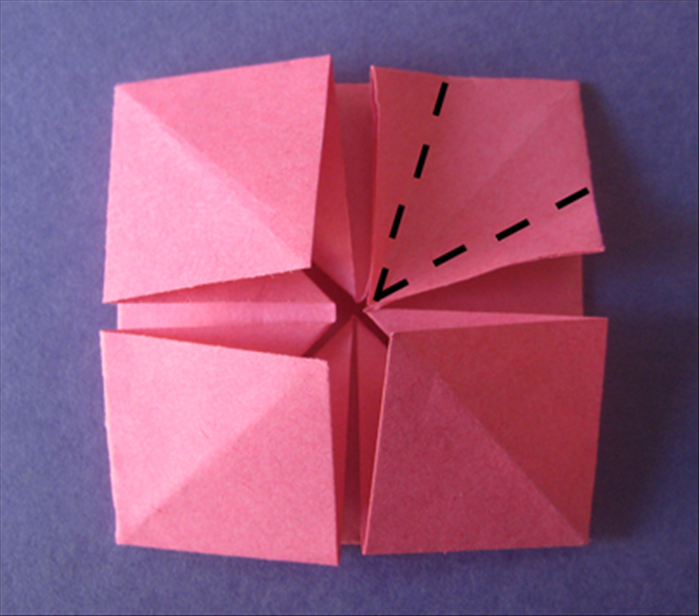 Fold the sides to the center crease.