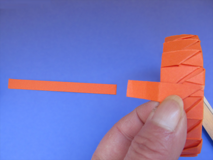 <p> When you have completely covered the band, the last strip should align inside of the band.</p>  <p> Unfold the last fold, put glue on it and refold.</p>  <p> &nbsp;</p>