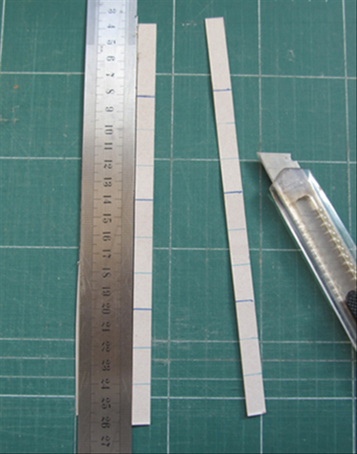 Cut strips the width you want the sides to be. In this case 1 inch. Leave an extra ½ inch at one end of each strip for gluing it together