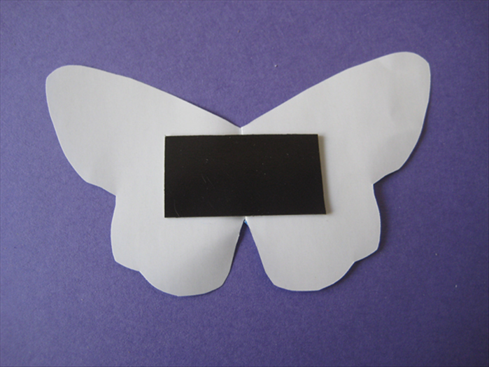 Place the printed glued side on the center of the butterfly.