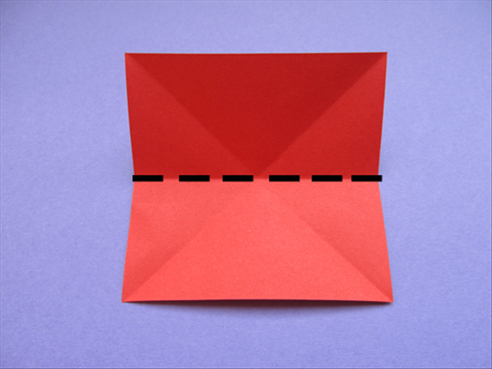 Rotate the paper so that the straight edges are at the top, bottom and sides.  Bring the bottom straight edge to the top to fold in half Crease and unfold