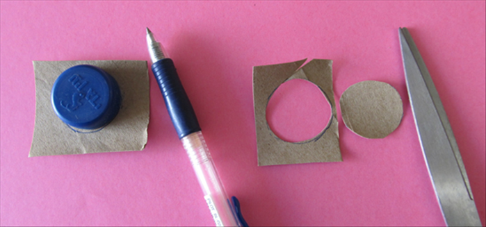 Flatten a leftover piece of  cardboard. Trace a circle around a bottle cap and cut it out