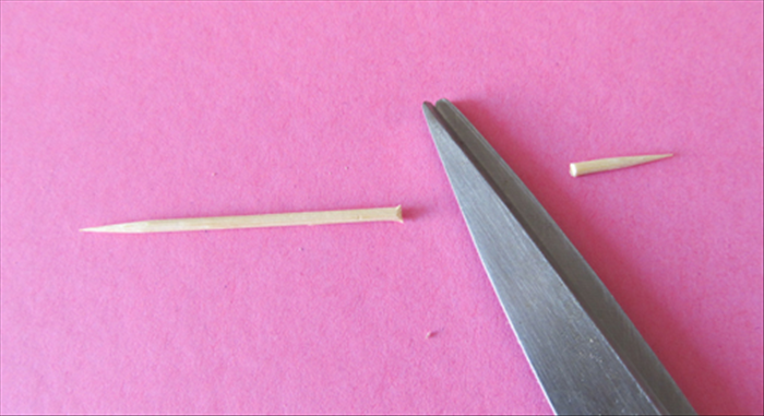 Cut off the tip of a toothpick