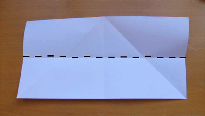 Open up the paper and fold it in half lengthwise.  Unfold