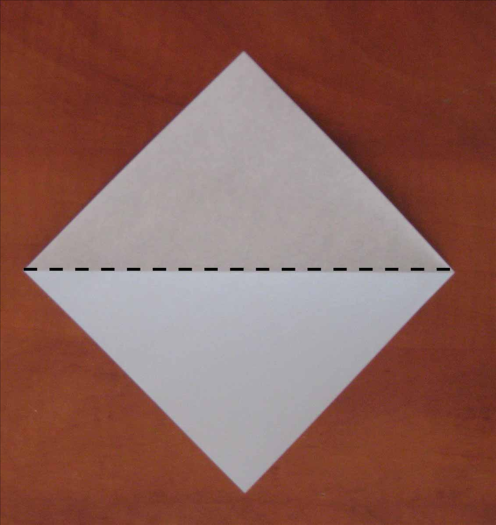 Place your square paper with the points on the top, bottom and sides. Fold it in half horizontally. Unfold